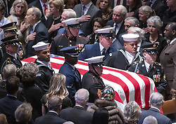 The casket carrying the remains of former United States President George H.W. Bush are brought in to the Washington National Cathedral to begin the National funeral service in honor of the late former President in Washington, DC on Wednesday, December 5, 2018.<br /> Photo by Ron Sachs / CNP/ABACAPRESS.COM