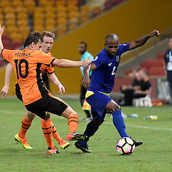 BRISBANE, AUSTRALIA - JANUARY 31: Serge Kaole of Global FC is tackled by Brett Holman of the Roar during the second qualifying round of the Asian Champions League match between the Brisbane Roar and Global FC at Suncorp Stadium on January 31, 2017 in Brisbane, Australia. (Photo by Patrick Kearney/Brisbane Roar)