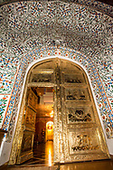 Low angle view of a golden colored metal door in Jaipur, India.