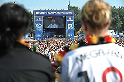 03.07.2010, Hyundai Fan Park, Hamburg, GER, FIFA Worldcup, Puplic Viewing Deutschland vs Argentinien  im Bild Fans mit Deutschland-Outfit beim Zuschauen vor der Tribuene.Foto ©  nph /  Witke