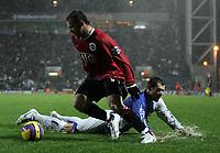 Photo: Paul Thomas.<br /> Blackburn Rovers v Manchester United. The Barclays Premiership. 11/11/2006.<br /> <br /> Wayne Rooney (L) of Man Utd beats a sliding Brett Emerton.
