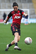 Portrait full length Manchester United forward Jess Sigsworth (9) warming up during the FA Women's Super League match between Manchester United Women and Manchester City Women at Leigh Sports Village, Leigh, United Kingdom on 14 November 2020.