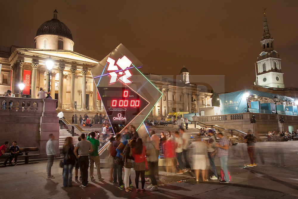 © licensed to London News Pictures. London, UK 27/07/2012. The Olympic countdown clock hits zero in Trafalgar Square as the Olympics opening ceremony starts on 27/07/12. Photo credit: Tolga Akmen/LNP