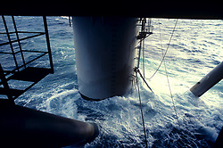 Stock photo of water churning under a jack up rig