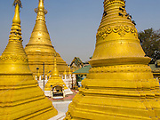 02 MARCH 2014 - MYAWADDY, KAYIN, MYANMAR (BURMA): Stupas at the Golden Pagoda, the most ornate Buddhist temple in Myawaddy, Myanmar. Myawaddy is separated from the Thai border town of Mae Sot by the Moei River. Myawaddy is the most important trading point between Myanmar and Thailand.    PHOTO BY JACK KURTZ