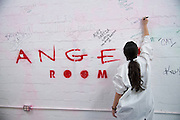 Diane Casanova signs the wall after her session at the Anger Room in Dallas, Texas on November 18, 2016. (Cooper Neill for The New York Times)