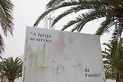 Catholic family values and morality on a billboard outside a church in Costa Nova, Aveiro, Portugal.