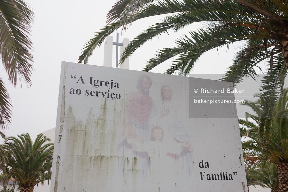 Catholic family values and morality on a billboard outside a church in Costa Nova, Aveiro, Portugal.