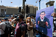 A man holds up an anti Dan Andrews sign during the Melbourne Freedom Rally at Parliament House. Police move into position on the steps of state parliament ahead of a planed protest. The groups who have organised the many Freedom Day protests over the last 3 months, attempted to march on State Parliament during Melbourne Cup Day demanding the sacking of Premier Daniel Andrews for the lockdown and attacks on their civil liberties. Police met with the protester's with significant force despite the city having had zero cases for five days. (Photo by Dave Hewison/Speed Media)