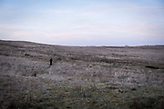 A lone man walks along the Senni valley moorlands of the Brecon Beacons National Park on 21st February 2019 in Brecon, Powys, Wales, United Kingdom.