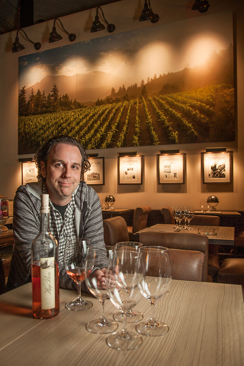 """Damian Lagle, Wine Guide, at the Huge Bear Tasting Room in Calistoga, CA.  """"I went from growing grapes to the retail side of the business...I love the interaction of the retail side but I miss the vinyard...growing grapes, like growing anything, its acheiving zen.""""  damian@hugebearwines.com"""