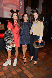 Left to right, BIP LING, DIONNE BROMFIELD and EVANGELINE LING at the YSL Beauty: YSL Loves Your Lips party held at The Boiler House,The Old Truman Brewery, Brick Lane,London on 20th January 2015.