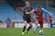 John McAtee (45) of Scunthorpe United battles for possession with Brad Halliday during the Pre-Season Friendly match between Scunthorpe United and Doncaster Rovers at Glanford Park, Scunthorpe, England on 15 August 2020.