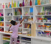 Legacy Jackson, 9, reaches for art materials at the art supply wall. The Magic House had two fourth-grade classes from the New City School visit their new permanent satellite location at 5127 Delmar Boulevard in St. Louis, MO on Wednesday May 23, 2019.<br /> Photo by Tim Vizer