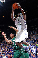 Kansas State forward Cartier Martin (20) goes to the basket and scores against Chicago State during the first half at Bramlage Coliseum in Manhattan, Kansas, January 22, 2007.  K-State leads the Cougars at halftime 38-17.