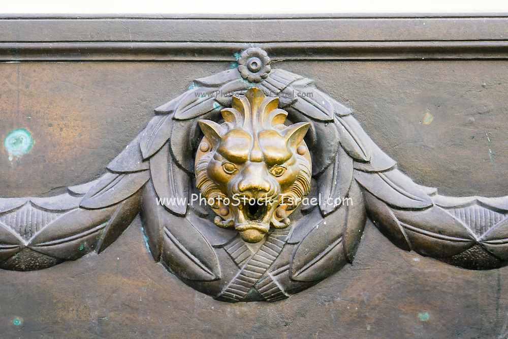 lion head statue as an element on a building in Old Town, Riga, Latvia