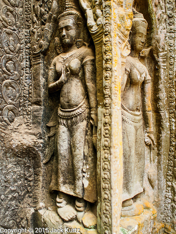 """14 MARCH 2105 - SIEM REAP, SIEM REAP, CAMBODIA: Apsara Dancers in a wall in Ta Prohm, a temple in the Angkor Wat complex. The area known as """"Angkor Wat"""" is a sprawling collection of archeological ruins and temples. The area was developed by ancient Khmer (Cambodian) Kings starting as early as 1150 CE and renovated and expanded around 1180CE by Jayavarman VII. Angkor Wat is now considered the seventh wonder of the world and is Cambodia's most important tourist attraction.    PHOTO BY JACK KURTZ"""