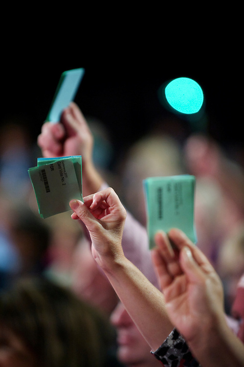 Labour party delegates raise their hands for a vote during the during the Labour Party Conference in Manchester on 28 September 2010.