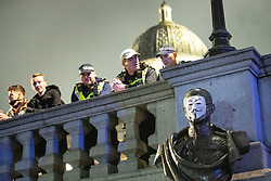 © Licensed to London News Pictures . 05/11/2019. London, UK. A mask is placed on a bust of John Jellicoe, 1st Earl Jellicoe in Trafalgar Square . Supporters of Anonymous , many wearing Guy Fawkes masks , attend the Million Mask March bonfire night demonstration , in Trafalgar Square in central London . Photo credit: Joel Goodman/LNP