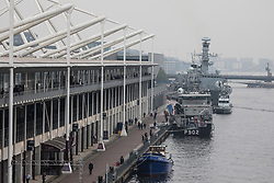 London, UK. 14th September, 2021. A BNS Pollux (P902) Belgian coastal patrol vessel and HMS Argyll are pictured moored alongside ExCeL London on the first day of the DSEI 2021 arms fair. Activists from a range of different groups have been protesting outside the venue for one of the world's largest arms fairs for over a week.