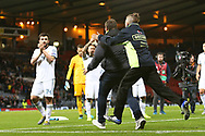 Security catches the Russian fan who ran on to the field at the end of the UEFA European 2020 Qualifier match between Scotland and Russia at Hampden Park, Glasgow, United Kingdom on 6 September 2019.