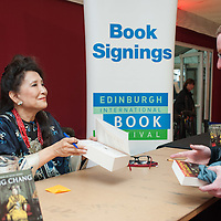 Jung Chang signing copies of her book for the public at the Edinburgh International Book Festival 2014<br /> <br /> Photograph by Pascal Saez/Edinburgh International Book Festival