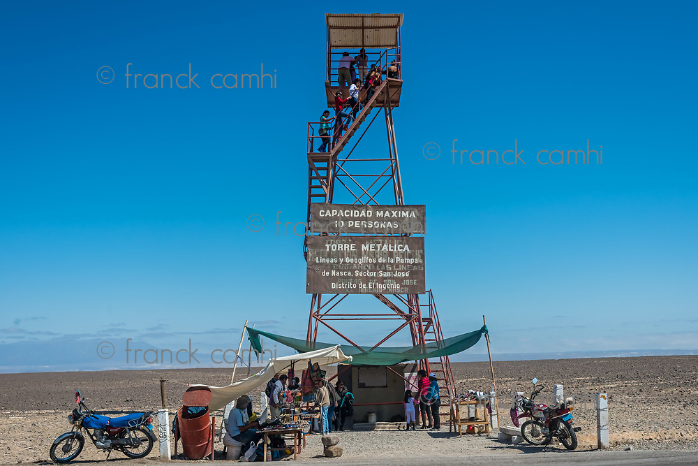 Nazca, Peru - July 31, 2013: people at the nazca lines observation tower in the peruvian coast at Ica Peru on july 31, 2013
