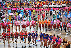 Aug. 28, 2017 - Baoting, China - Tourists and local people of Li and Miao ethnic groups dance to celebrate the water festival as well as the traditional Qixi Festival, or Chinese Valentine's Day, in Baoting County, south China's Hainan Province.  (Credit Image: © Guo Cheng/Xinhua via ZUMA Wire)