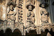 South Porch, Left Portal (Martyrs). Archivolts - Stephen Disputes with the Jews (Acts 6:9). Cathedral of Chartres, France.  A UNESCO World Heritage Site. .