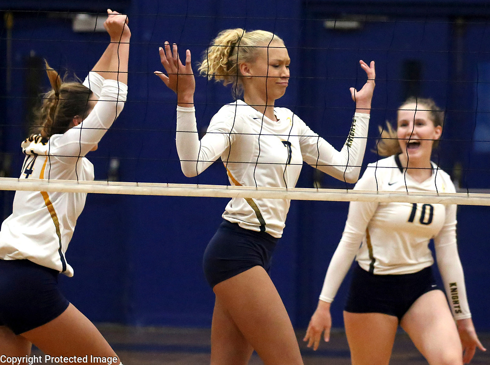 Soquel High middle blocker Renee Parker brings a bit of attitude to the court after stuiffing a shot by Harbor High's front line during Soquel's 5-set victory.<br /> Photo by Shmuel Thaler <br /> shmuel_thaler@yahoo.com www.shmuelthaler.com