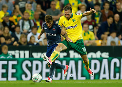 Charlton Athletic's Billy Clarke and Norwich City's Marco Stiepermann