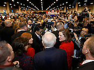 Berkshire Hathaway Chairman Warren Buffet is surrounded by press, shareholders and security as he wanders the company trade show before his company's annual meeting in Omaha, Nebraska April 30, 2011. Dozens of BH companies had displays in the building next to the site of the meeting.  REUTERS/Rick Wilking  (UNITED STATES)