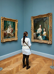 Woman looking at paintings at Metropolitan Museum of Art in Manhattan , New York City, USA