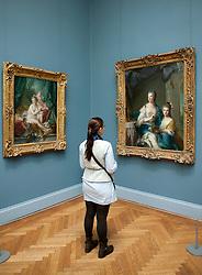 Woman looking at paintings at Metropolitan Museum of Art in Manhattan , New York City, USA