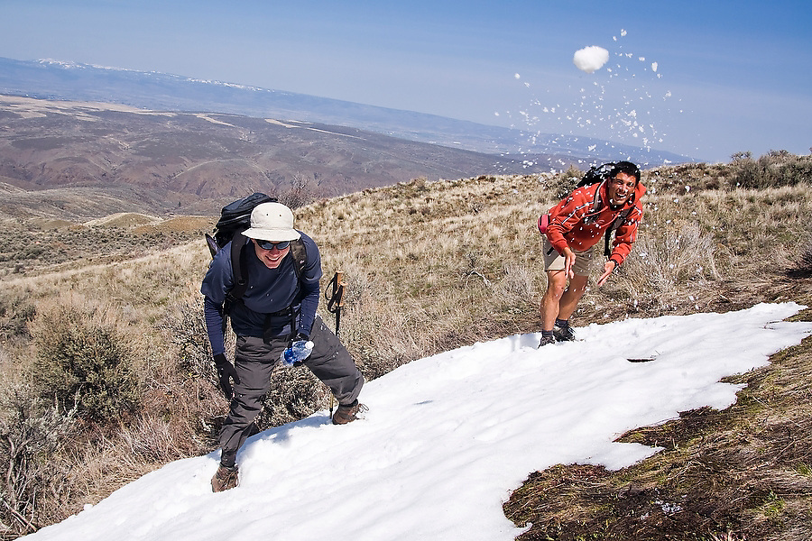 HIkers enjoy a late season snowball fight on Umtanum Ridge, Umtanum Creek Recreation Area near Yakima, Washington.