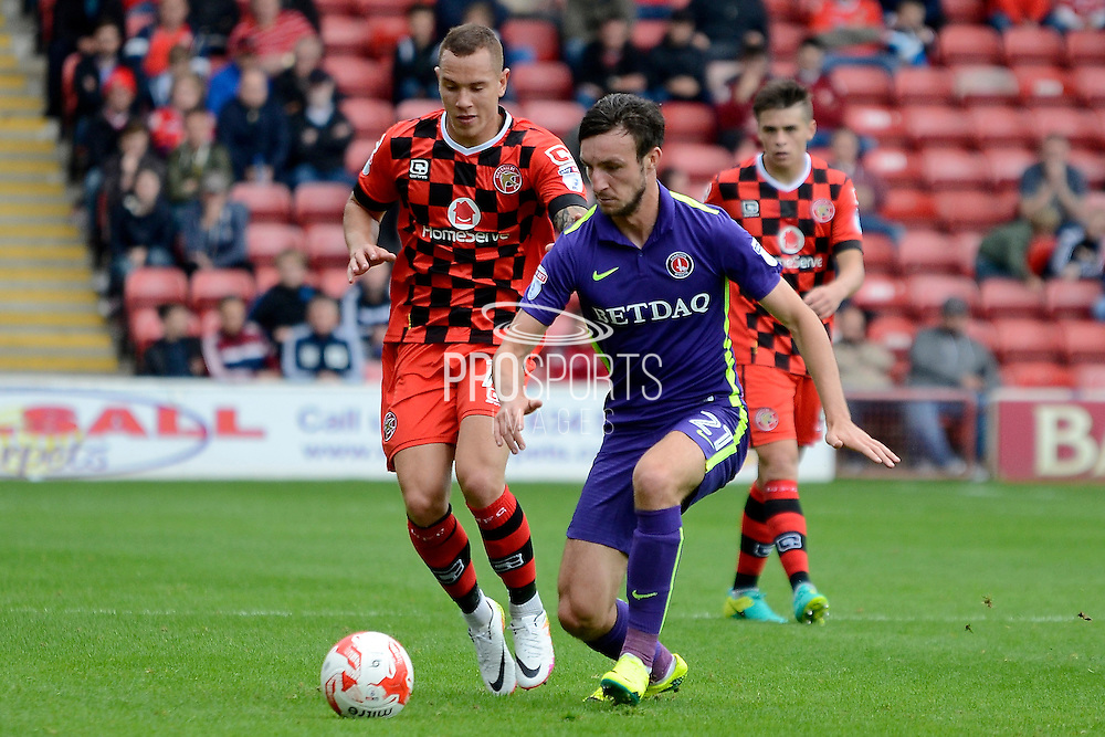 Charlton Athletic defender Morgan Fox (21) and Walsall midfielder Kieron Morris (11) battles for possession 1-1 during the EFL Sky Bet League 1 match between Walsall and Charlton Athletic at the Banks's Stadium, Walsall, England on 20 August 2016. Photo by Alan Franklin.