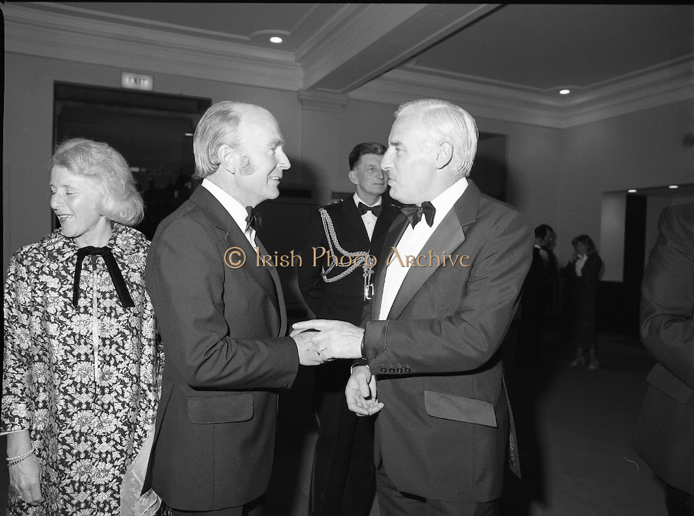 State Opening Of The National Concert Hall. (N92)..1981..09.09.1981..9th September 1981..The President ,Dr Patrick Hillery, officially opened the new National Concert Hall,Earlsfort Terrace, Dublin. The state opening was followed by the premier concert performed by the Radio Telefís Eireann Symphony Orchestra with a large cast of soloists, choirs and the RTESO leader Audrey Park and conducted by RTE's Principal conductor Colman Pearce...Image of Peter Barry TD in conversation with President Hillery at the National Concert Hall.