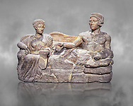 Etruscan cinerary, funreary, urn cover depicting a husband and wife,  from the Padata Necropolis, Chianciano, end of 5th century B.C., inv 94352 National Archaeological Museum Florence, Italy , grey art background .<br /> <br /> If you prefer to buy from our ALAMY PHOTO LIBRARY  Collection visit : https://www.alamy.com/portfolio/paul-williams-funkystock - Scroll down and type - Etruscan Florence - into LOWER search box. (TIP - Refine search by adding a background colour as well).<br /> <br /> Visit our ETRUSCAN PHOTO COLLECTIONS for more photos to download or buy as wall art prints https://funkystock.photoshelter.com/gallery-collection/Pictures-Images-of-Etruscan-Historic-Sites-Art-Artefacts-Antiquities/C0000GgxRXWVMLyc