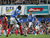 Photo: Lee Earle.<br /> Portsmouth v Reading. The Barclays Premiership. 28/10/2006. Portsmouth's Kanu (L) heads home their second.