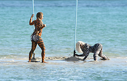 EXCLUSIVE: Rapper Cardi B. wears tiger body paint as she twerks on a sandbar during a video shoot in Miami. Cardi and fellow rappers known as City Girls were all dressed in barely there body paint looks and were seen twerking and riding jet skis during the shoot. The shoot was even complete with a floating stripper pole full off dancers. Earlier in the day, it was reported that Cardi had failed to show up for a court appearance in New York. 03 Dec 2018 Pictured: Cardi B. Photo credit: MEGA TheMegaAgency.com +1 888 505 6342