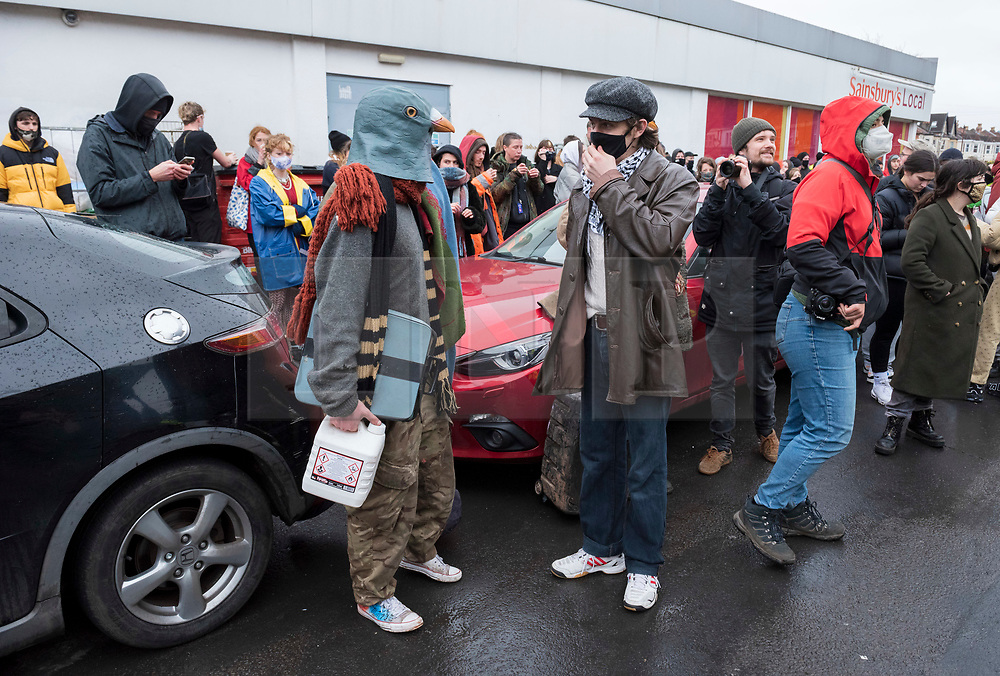 © Licensed to London News Pictures; 10/03/2021; Bristol, UK. A person wearing a pigeon head piece is evicted from a large empty office building by Police and bailiffs on Gloucester Road in North Bristol. The squatters say they are called The Pigeon Shit Collective, because of the Government's failings, and they are giving support to homeless people and those in need during the covid-19 coronavirus pandemic. Photo credit: Simon Chapman/LNP.