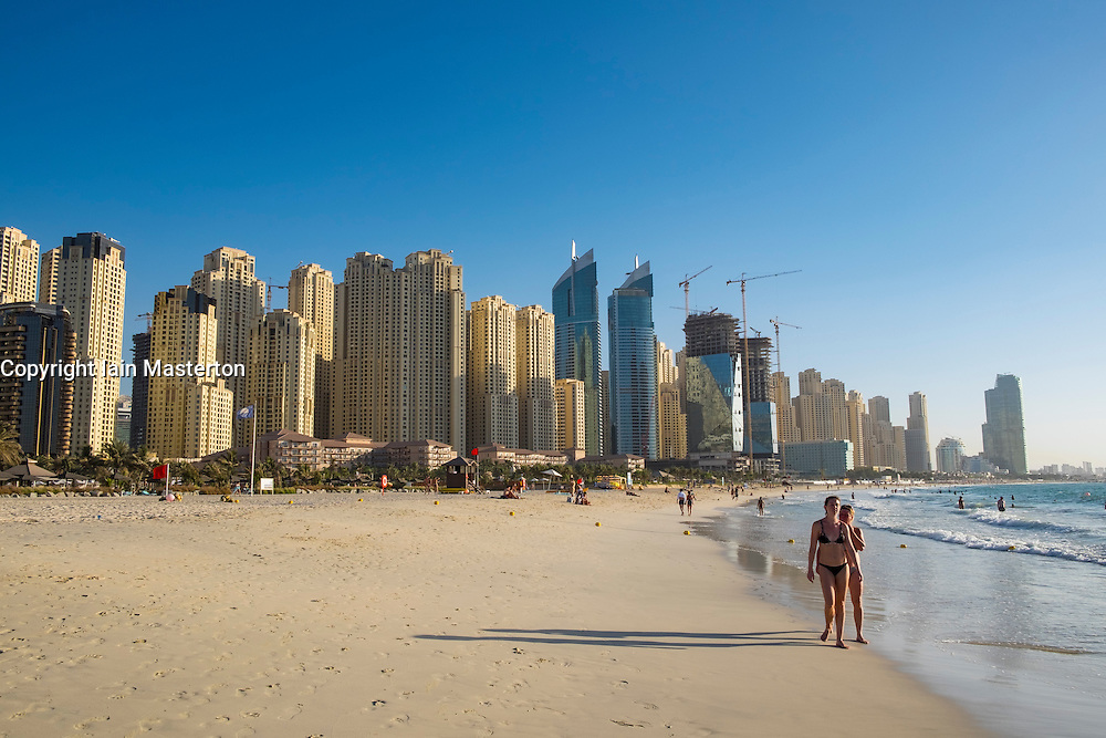View of skyline of modern skyscrapers and beach at Marina district of Dubai United Arab Emirates