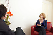 A female therapist during a one on one session with a client seeking help