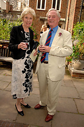 JOAN MORECAMBE and ANTHONY ROBINSON at the Lady Taverners Westminster Abbey Garden Party, The College Garden, Westminster Abbey, London SW1 on 10th July 2007.<br />