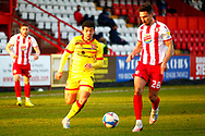 Josh Gordon of Walsall goes in for a tackle with Joe Martin of Stevenage during the EFL Sky Bet League 2 match between Stevenage and Walsall at the Lamex Stadium, Stevenage, England on 20 February 2021.