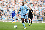 Yaya Toure of Man city in action. Barclays premier league match, Manchester city v Chelsea at the Etihad stadium in Manchester,Lancs on Sunday 21st Sept 2014<br /> pic by Andrew Orchard, Andrew Orchard sports photography.