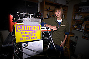 Taylor Wilson stands next to his fusion reactor, or fusor, in a laboratory in the Physics Department at the University of Nevada, Reno. Taylor Wilson is the youngest individual on Earth to have achieved a nuclear fusion reaction.