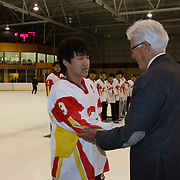 Jin Chen, China, receives the 'Best Player of the Team' award for the tournament from Kai Hietariinta, IIHF Tournament Chairman at the conclusion of the 2012 IIHF Ice Hockey World Championships Division 3 held at Dunedin Ice Stadium. Dunedin, Otago, New Zealand. 22nd January 2012. Photo Tim Clayton