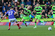 Forest Green Rovers Isaac Pearce(17) is brought down by Exeter City midfielder Archie Collins (27) during the EFL Sky Bet League 2 match between Forest Green Rovers and Exeter City at the New Lawn, Forest Green, United Kingdom on 4 May 2019.