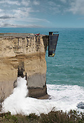 Now that's living on the edge! Concept house is pinned to the side of a cliff with unrivalled views of the Indian Ocean<br /> <br /> If you've ever wanted to have the ocean right at your door, this concept property on the Australian southwest coast seems to be precariously clinging to the side of a cliff - just metres above the sea.<br /> <br /> The aptly named Cliff House extends off a vertical rock face and is anchored to the cliff side with support beams.<br /> <br /> Cliff House was conceived of by Australian prefab architecture specialists Modscape Concept, who were inspired by the shape of barnacles clinging to the hull of a ship.<br /> <br /> The concept home, which seems to almost propel off the overhang, makes the property look as if it is an extension of the landscape. On their website, the architects say that their aim is to create 'an absolute connection with the ocean.'<br /> <br /> The five-storey home will be made from prefab modules which are arranged in a vertical floor plan. <br /> <br /> Each 'room' or floor will then be stacked atop the other and held in place with engineered steel pins which are driven into the cliff face.<br /> <br /> Residents will enter the property from the cliff top at floor level and will use an elevator or stairs to descend to the bedroom, living area and kitchen.<br /> <br /> The lowest floor of the concept home will comprise an outdoor space which seemingly floats about the water and a stunning – if rather scary – view of the ocean awaits.<br /> <br /> The distinctive design solution came about after Modscape Concept were asked by a couple to create a property on Australia's southwest coast, where they owned some land. <br /> ©Modscape/Exclusivepix
